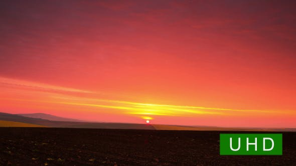 Thumbnail for Sunrise over a Plowed Field