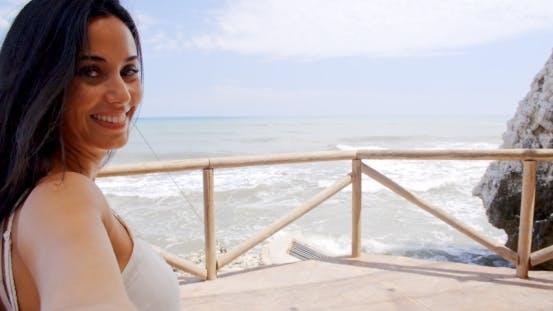Thumbnail for Brunette Woman Taking Self Portrait By Ocean