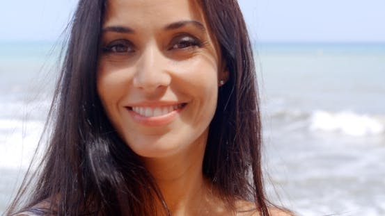 Pretty Woman At Beach With Happy Facial Expression