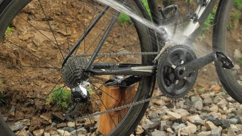 Washing bike chain and cassette with water. Bike wash with hose