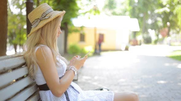 Thumbnail for Girl Using Smartphone in Park