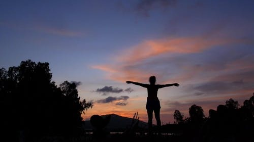Success Concept Of Woman Silhouette With Arms