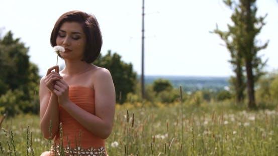Thumbnail for Girl Blowing On White Dandelion