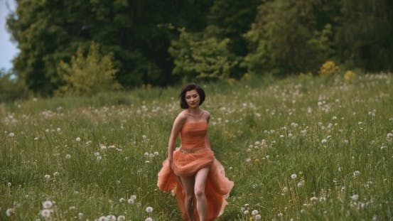 Thumbnail for Girl Running On Meadow With Sunset