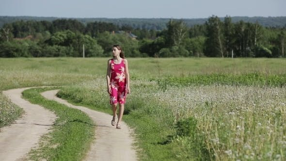 Thumbnail for Girl Walking By Road In Field