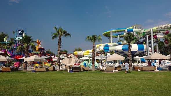 Amusement Park Water Pool with Slides People Relax