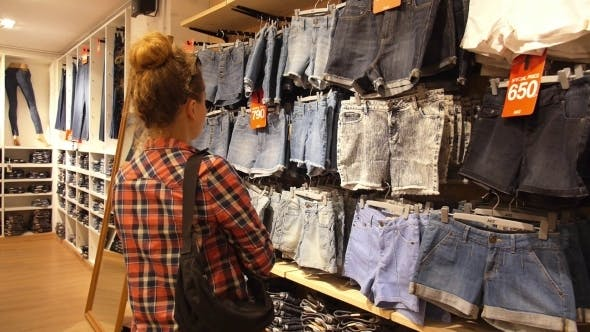 Thumbnail for Young Woman Shopping for Clothes in Fashion Store