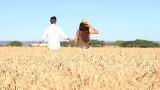 Cover Image for Couple Running On A Field