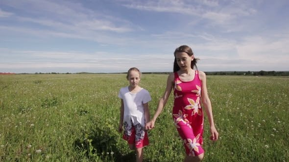 Thumbnail for Young Girls Walking Holding Their Hands