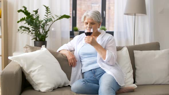 Cover Image for Senior Woman Drinking Red Wine From Glass at Home