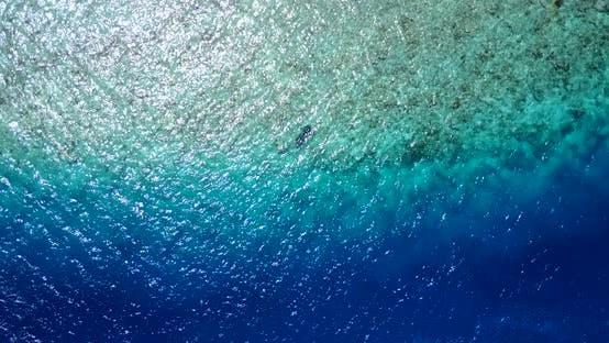 Wide angle overhead copy space shot of a summer white paradise sand beach and aqua turquoise water