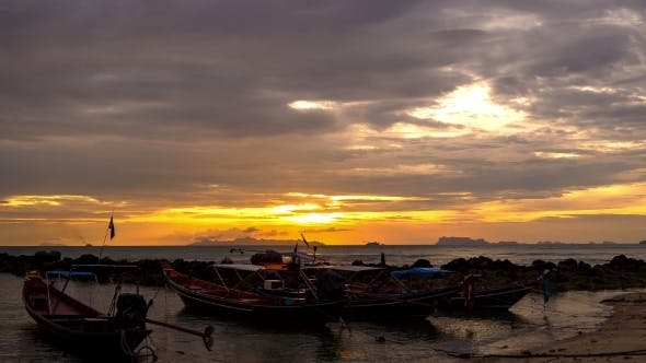 Thumbnail for 4K. Time Lapse. Traditional Thai Boats At Sunset