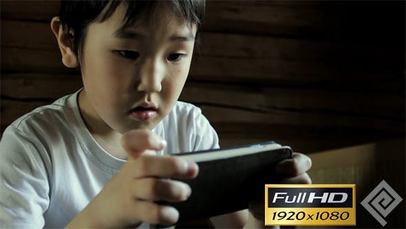 Thumbnail for Kid Playing On Smartphone #2