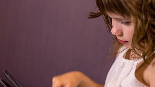 Thumbnail for Kid Girl Uses Tablet