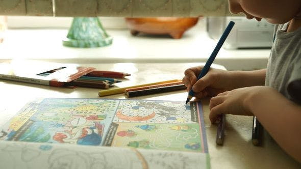 Child Is Painting A Pencils On A Paper
