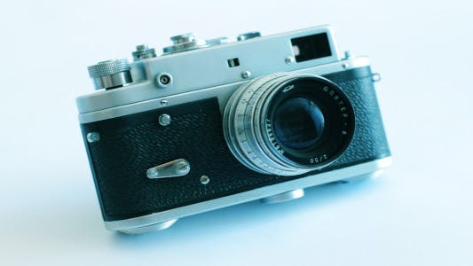 Cover Image for Old Camera On A White Background