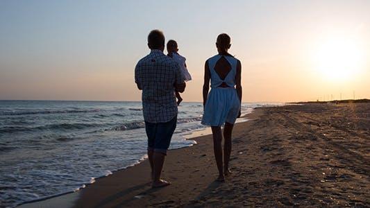 Thumbnail for Family Walking Along the Seashore
