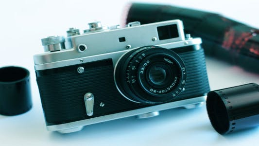 Cover Image for Old Camera On A White Background 3