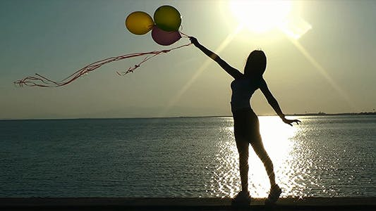 Thumbnail for Girl Playing with Ballons at Seaside