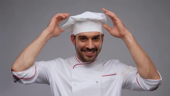 Happy Smiling Male Chef Adjusting Toque
