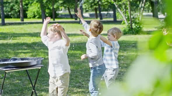 Cover Image for Excited Children Bursting Giant Bubble