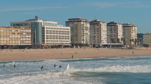 People swimming near the Seixal beach, Lisbon, on a sunny winter day.