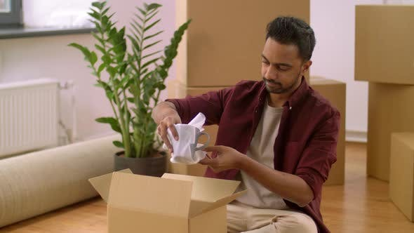 Thumbnail for Indian Man Packing Boxes and Moving To New Home 31