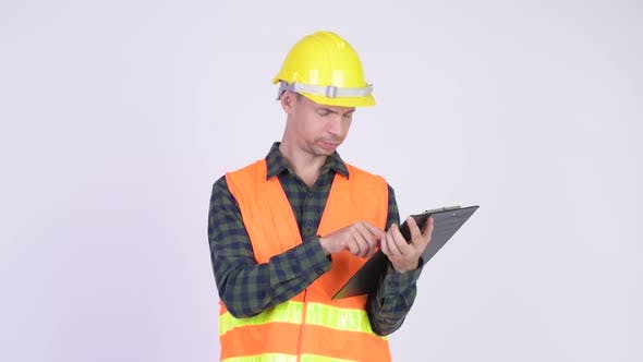 Cover Image for Studio Shot of Man Construction Worker Holding Clipboard and Directing
