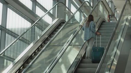 Woman Going Up the Escalator with Her Suitcase, Slow Motion, BMPCC