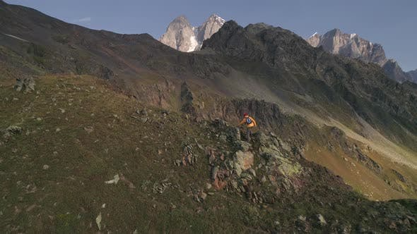 Thumbnail for Aerial Slow-motion Shot of a Man Climbing Mountains on a Sunny Day in Autumn.