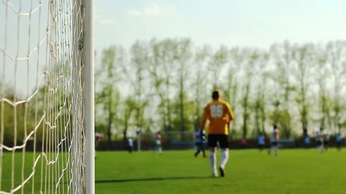 Goalkeeper And Players Is On A Football Field