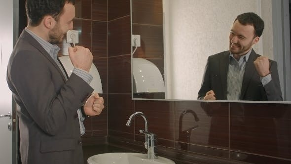 Thumbnail for Businessman Takes a Look At Himself In The Mirror.