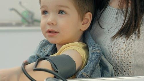 Medical Worker Taking Boy's Blood