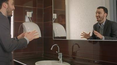 Businessman Looking At Himself In Mirror