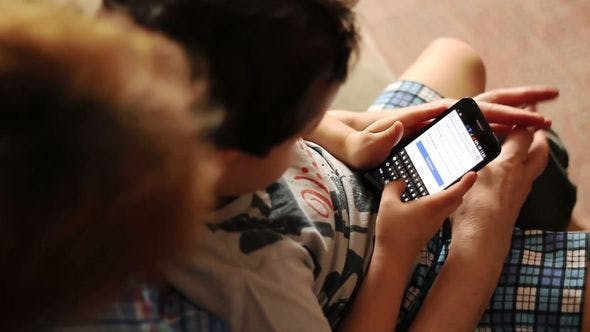 Thumbnail for Child Is Typing A Text On A Smartphone