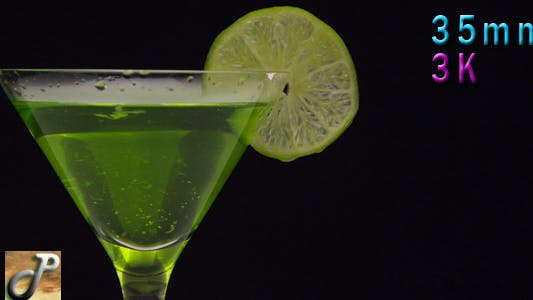 Thumbnail for Cocktail In Martini Glass With Green Lime
