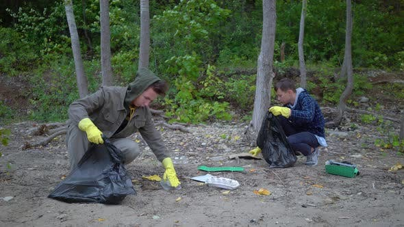 Thumbnail for Volunteers with Garbage Bags Cleaning Forest