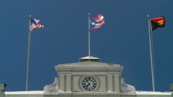 Thumbnail for Flags Fly Atop Government Building