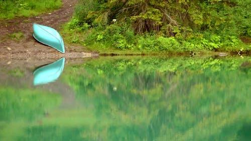 Canoe On The Lake Shore