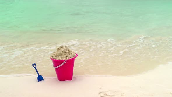 Thumbnail for Childs Bucket And Shovel Sitting On Tropical Beach