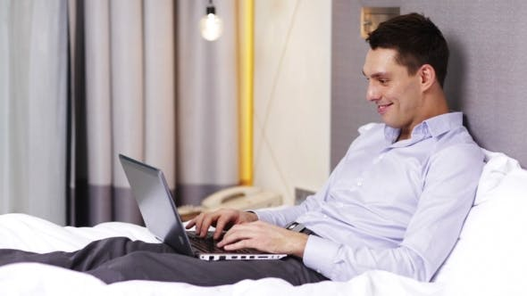 Thumbnail for Businessman With Laptop Lying In Bed And Typing