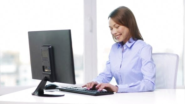 Thumbnail for Happy Businesswoman With Computer In Office