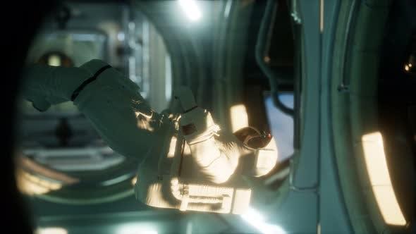 Astronaut Inside the Orbital Space Station