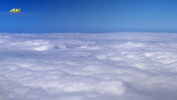 Thumbnail for Flying Over Clouds from Airplane Window