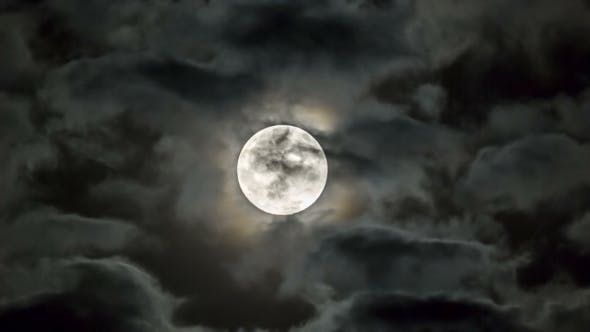 Bright Moon Among Moving Clouds