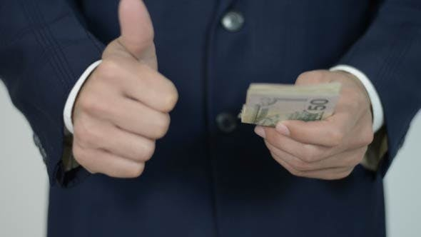 Thumbnail for Businessman Counts Money, Thumb up