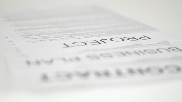 Thumbnail for Contract, Business Plan and Project on Table
