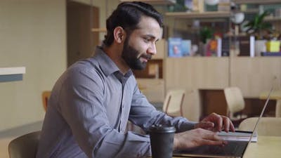 Happy Indian Businessman Working on Laptop Computer From Home Office
