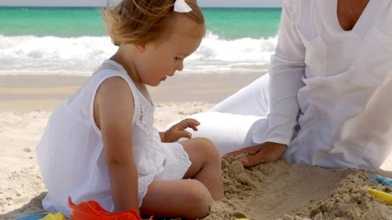 Thumbnail for Little Girl Playing On a Tropical Beach