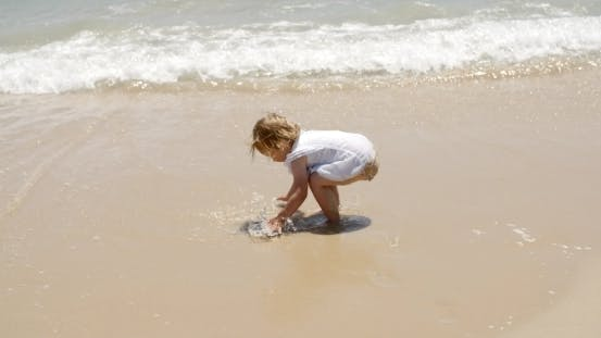 Thumbnail for Little Girl Playing In The Sea